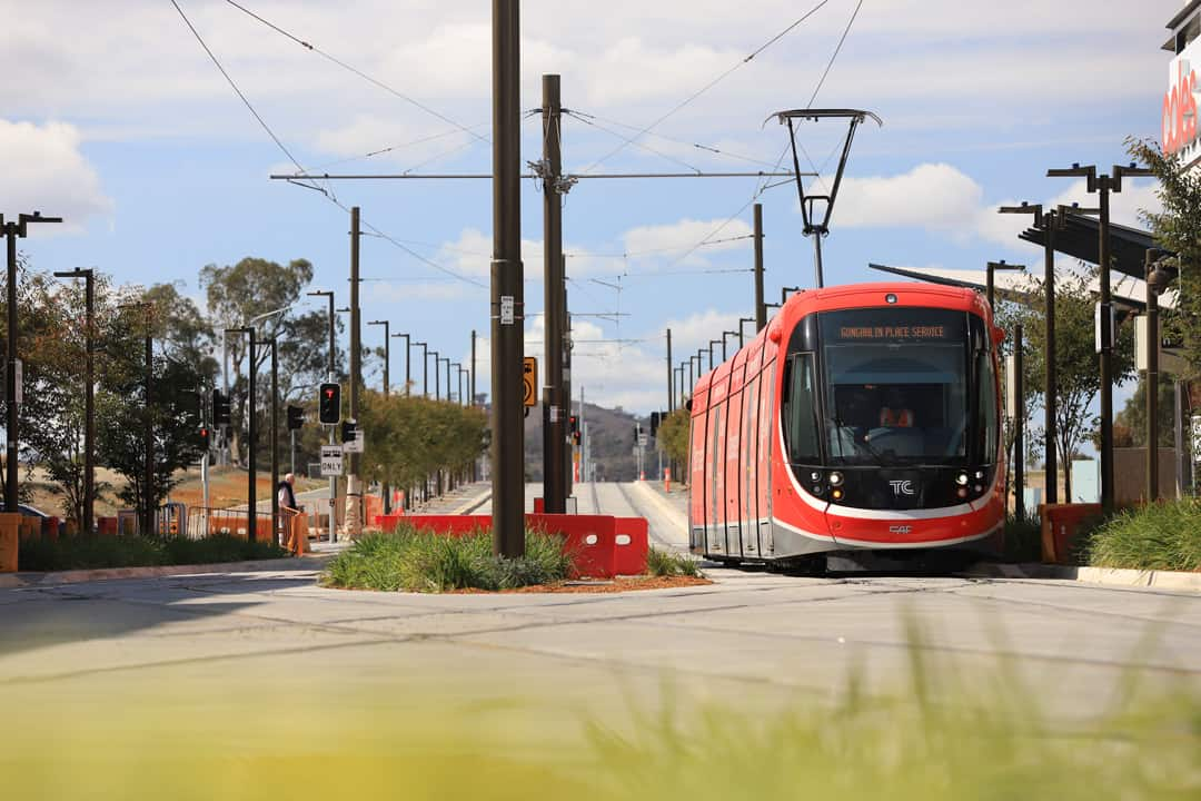 Canberra Metro light rail vehicle driving through Gungahlin area